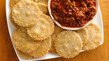Sesame Mini Pitas with Roasted Red Pepper Tapenade