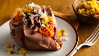 Jamaican Loaded Baked Sweet Potatoes with Pulled Pork and Mango Rum Salsa