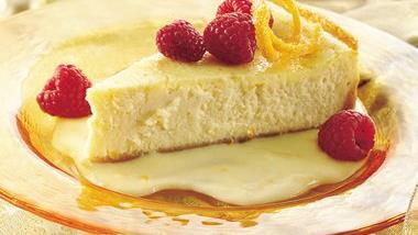 Luscious Orange Cheesecake with Raspberries