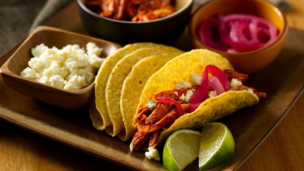 Chile and Roasted Garlic Pulled Chicken Crunchy Tacos