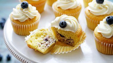 Blueberry Cheesecake-Stuffed Lemon Cupcakes with Vanilla Frosting