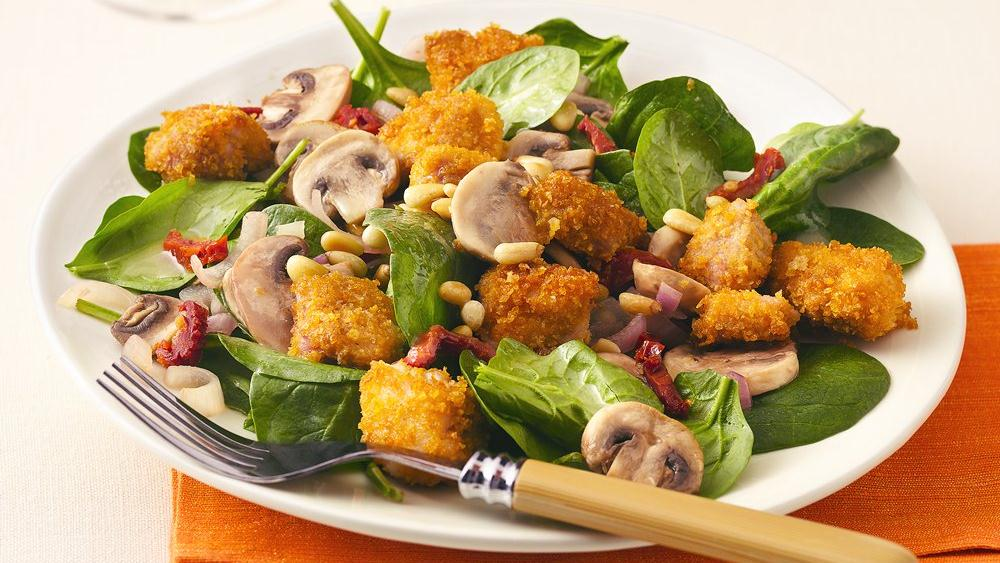Garlic Chicken over Baby Spinach with Toasted Pine Nuts